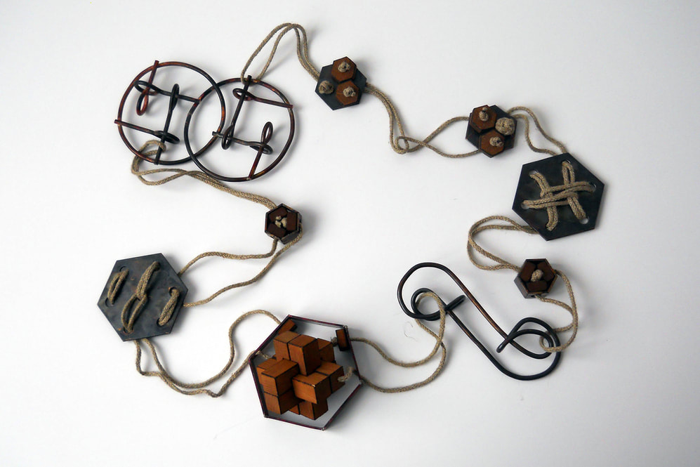 Necklace Connected is made of copper and hempen rope and consists of several puzzles.