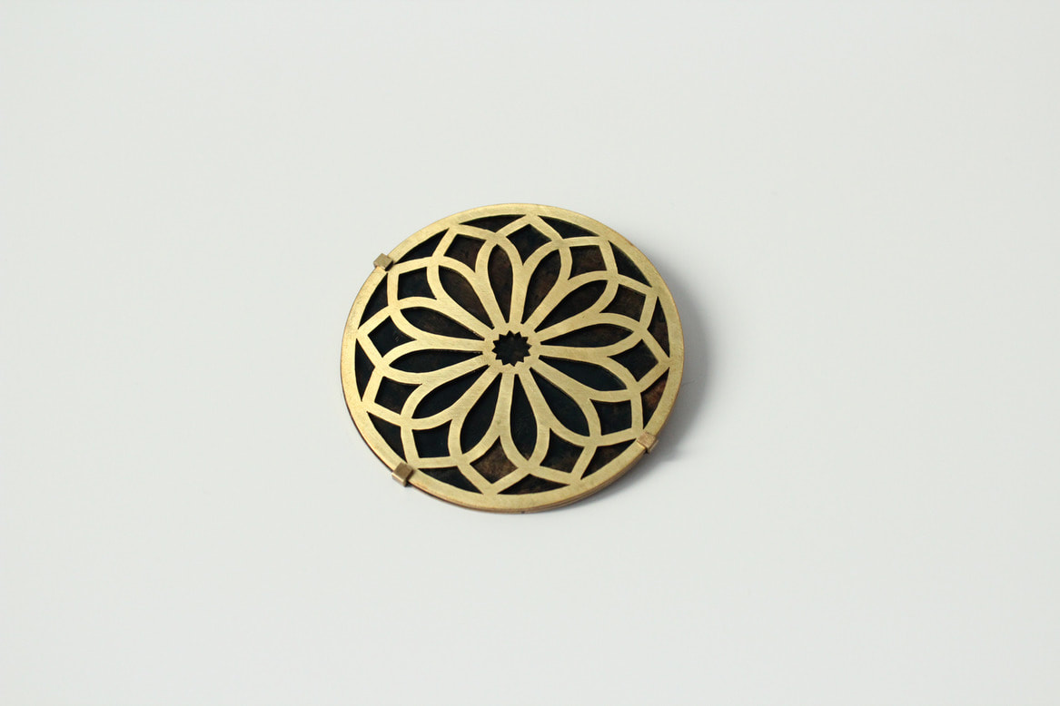 Brooch with an Indian ornament on it. It's part of my diploma.