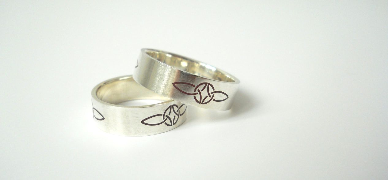 Weddings rings made of sterling silver with celtic knotwork.