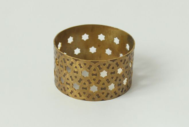 Bracelet with an Indian ornament etched/cut into it. From the diploma work Taka Takadimi Takadimi Taka Takadimi.