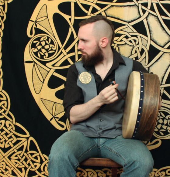 Picture from the shooting with jewellery pieces from my diploma while playing on my Bodhrán.